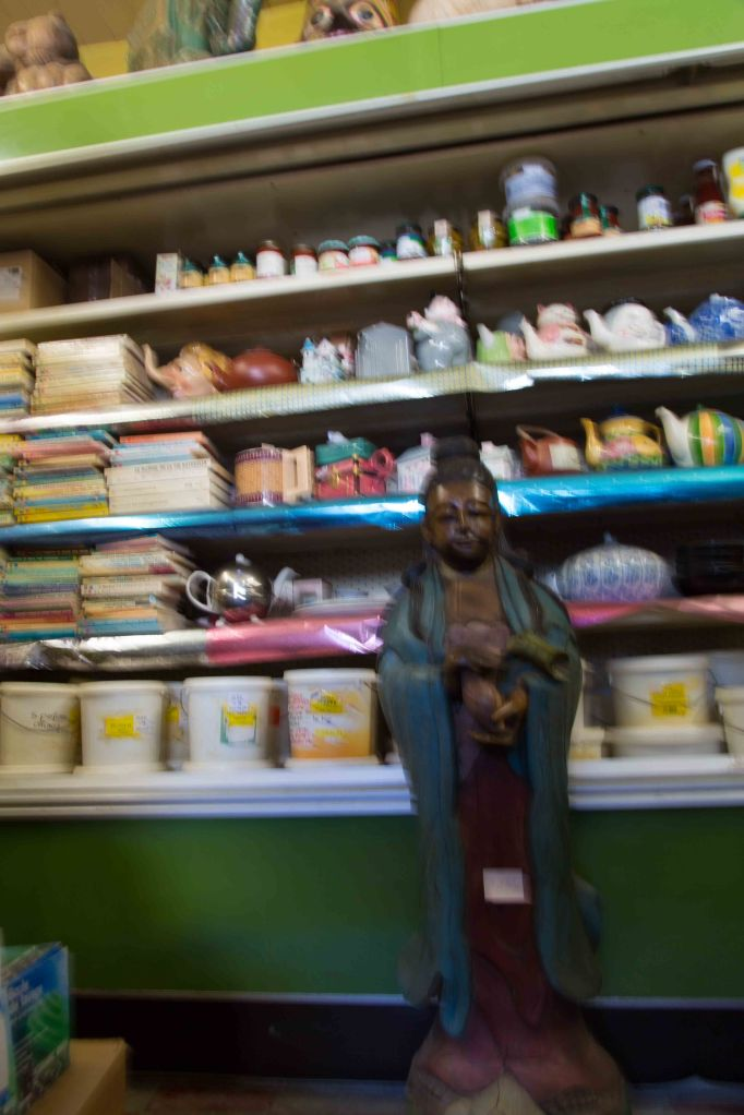 I'm sorry this photo is so blurry but it does give you an idea of the eclectic assortment of the products inside. Seriously, no B-school graduate ever consulted on this place and I love it for that. I bought one of those teapots behind the Buddha. Mine is in the shape of a cabbage. I got nori flakes and organic grapeseed oil; all the food is organic. I thought I would have to bring nori from Paris. I bypassed the wine, the books, the jewelry, the Mariage Freres tea, but I did get a magic powder, Gui. Apparently you do a ritual -- I have to find out what that is -- and disperse the powder in front of your door. It brings you happiness, peace, prosperity -- Suzanne will like that -- and health.  The last time I was at the house I found hundreds of dead bees, just inside the door. I don't know how the previous owner managed that. I also find containers of long-dead leaves and herbs, this despite the fact that the house was emptied of its contents. These things were deliberately left, with everything around them cleared out. Whatever the weirdness is, I'm not above using a little magic to dispel it. I'm glad kind, eccentric women like Mme. Diremszian are around to provide them for me.